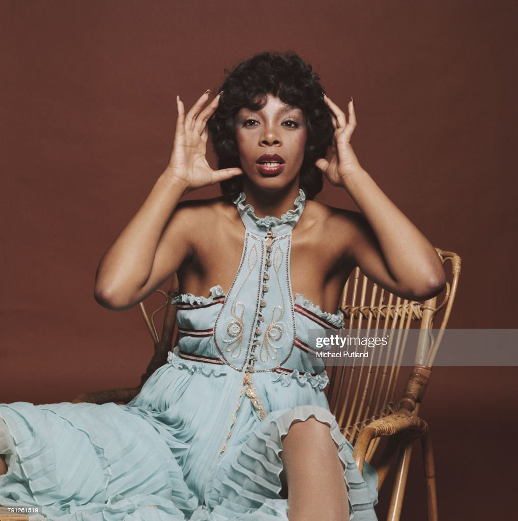 American pop, soul and disco singer and songwriter, Donna Summer (1948 - 2012), pictured seated on a wicker chair in London, 29th April 1976.