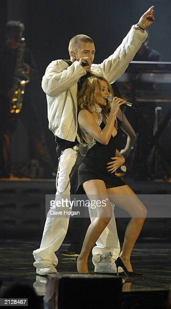 American pop star Justin Timberlake and Australian singer Kylie Minogue flirt on stage during a duet at the 2003 Brit Awards held at Earl's Court in...