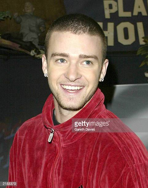 American pop star Justin Timberlake arrives at Planet Hollywood in London on January 26 2003