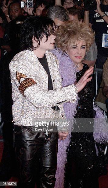 American pop star Michael Jackson and actress Elizabeth Taylor arrive at his 30th anniversary celebration show at Madison Square Gardens on September...