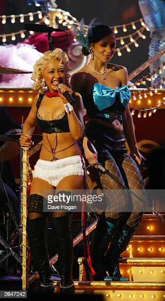 American pop stars Christina Aguilera and 'Mya' perform on stage at the 44th Grammy Awards 2002 on February 27 2002 in Los Angeles United States