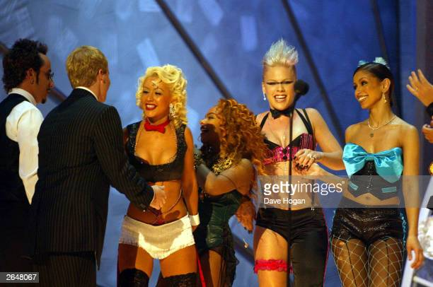 American pop stars Christina Aguilera 'Mya' 'Lil Kim' and 'Pink' perform on stage at the 44th Grammy Awards 2002 on February 27 2002 in Los Angeles...