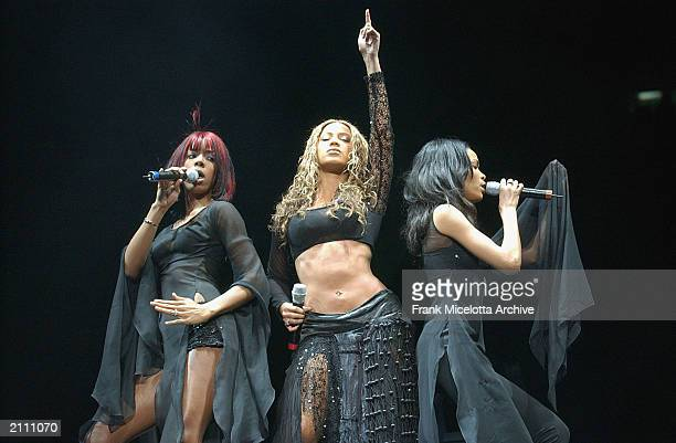American pop vocal group Destiny's Child, featuring singer Beyonce Knowles performs on stage at the '2002 Z100 Jingle Ball' concert at Madison Square...