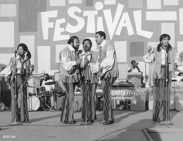 American pop vocal group the 5th Dimension performs on stage backed by a horn section for the Harlem Festival New York City They wear matching...