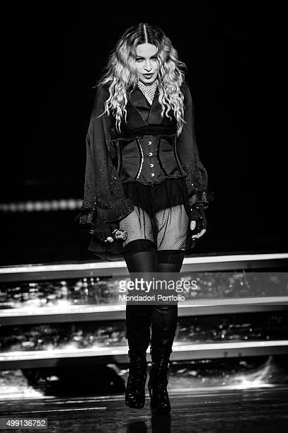 American popstar Madonna in a revealing black dress during her concert of 'Rebel Heart Tour' at PalaAlpitour Turin 19th November 2015