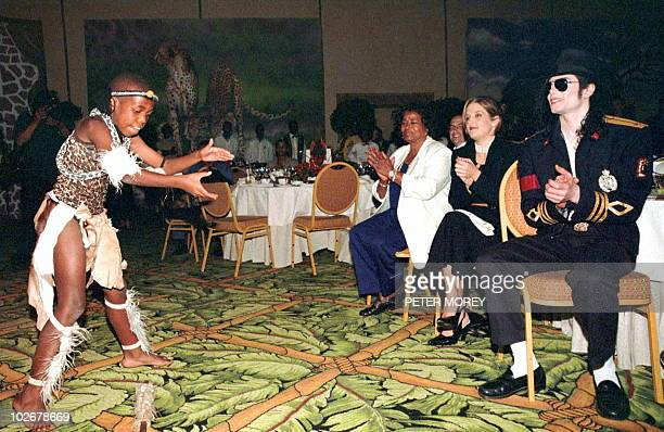American popstar Michael Jackson his former wife Lisa Marie Presley and his mother are enjoying the act of a young South African dancer at a private...