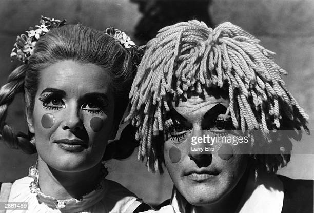 American popular entertainer and actor Dick Van Dyke in clown costume with Sally Ann Voak during the filming of 'Chitty Chitty Bang Bang'