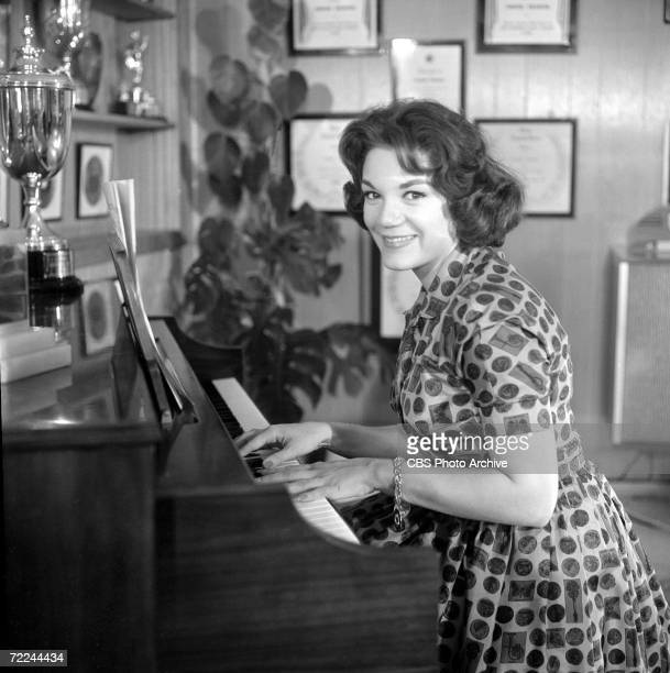 American popular singer Connie Francis plays the piano at home for an episode of the CBS celebrity interview program 'Person to Person' November 10...