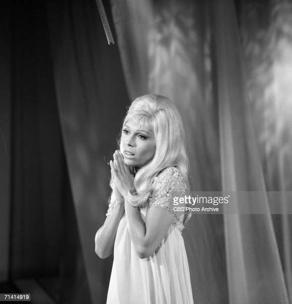 American popular singer Nancy Sinatra sings with her hands together before her during an appearance on the Ed Sullivan Show New York October 1 1967