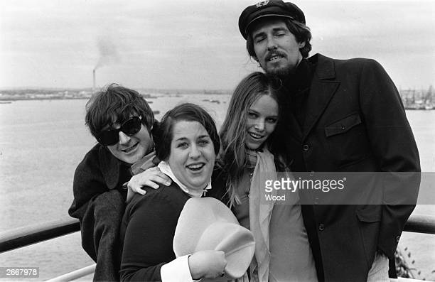 American popular singing group 'The Mamas and the Papas' arrive at Southampton England From l to r Canadianborn Denny Doherty Mama Cass Elliot...