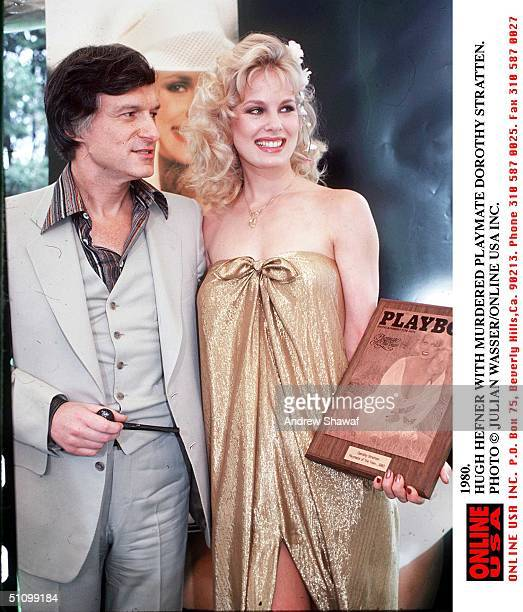 American pornographer Hugh Hefner and murdered Playboy PLaymate Dorothy Stratten 1980 She holds a plaque naming her 1980 Playmate of the Year