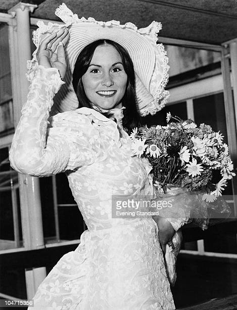 American pornographic actress Linda Lovelace arriving at London Airport 28th May 1974 She is wearing a lace dress and matching hat