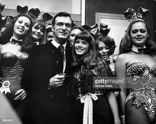 American pornography publisher and club entrepreneur Hugh Hefner with American actress Barbara Benton amongst English 'Bunny Girls' at his London...