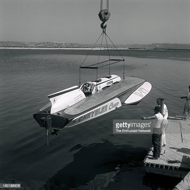 American Power Boat Association APBA San Diego Cup Hydroplane Race Mission Bay California Miss Chrysler Crew U77 Unlimited Hydroplane being lowered...