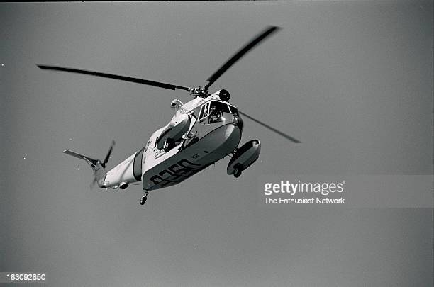 American Power Boat Association APBA San Diego Cup Hydroplane Race Mission Bay California US Coast Guard Sikorsky HH52A Sea Guard watches over the...