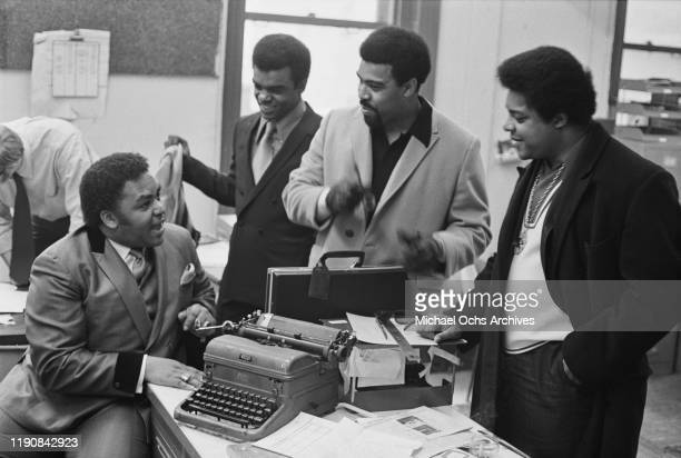 American preacher and singer Solomon Burke at the offices of 'R'n'B World' magazine in New York City, USA, with vocal trio the Isley Brothers, 6th...