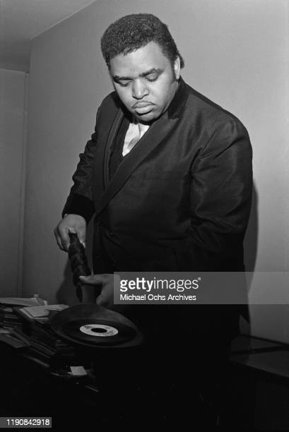 American preacher and singer Solomon Burke uses a large wooden spoon to handle his single 'I Can't Stop', released by Bell Records, USA, circa 1969....