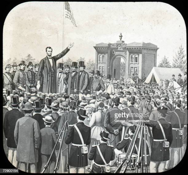 American President Abraham Lincoln raises his hand as he delivers the speech later known as the 'Gettysburg Address' to a large audience Gettysburg...