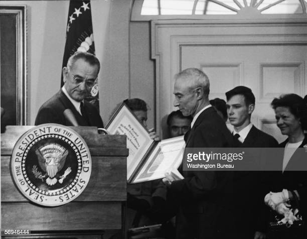 American President and former senator Lyndon B Johnson presents the Enrico Fermi Award to American nuclear physicist and father of the atom bomb...
