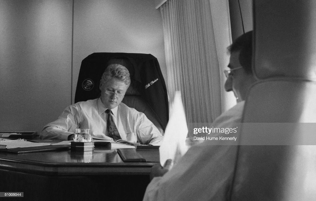 American President Bill Clinton and White House Chief of Staff Leon Panetta (left) work on board Air Force One while enroute to New York City, July 1996.