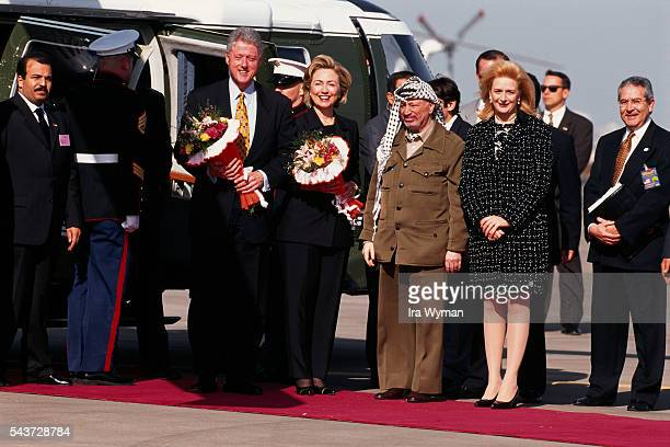 American President Bill Clinton and wife Hillary are welcomed at the Gaza airport by President of the Palestinian National Authority Yasser Arafat...