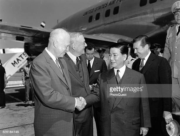 American President Dwight D Eisenhower and Secretary of State John Foster Dulles greet South Vietnamese President Ngo Dinh Diem at National...