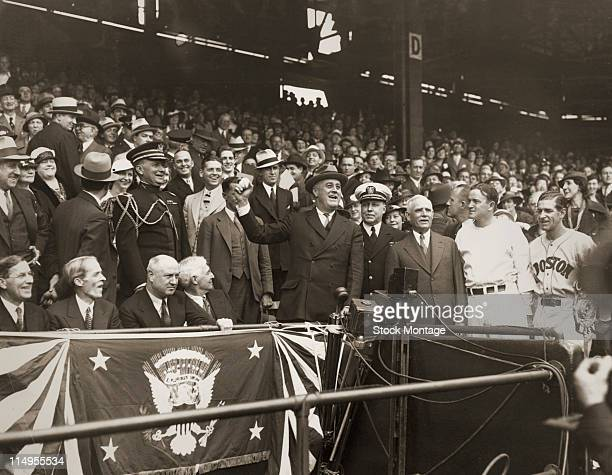 American President Franklin D. Roosevelt prepares to throw out the first ball to open the baseball season before a game at Griffith Stadium,...