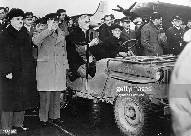 American President Franklin Delano Roosevelt in a jeep after arriving at Yalta airport for the Big Three Conference also in the photograph are...