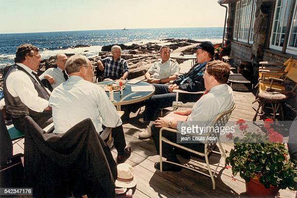 American President George Bush meets with Dick Cheney Lawrence Eagleburger Brent Scowcroft Robert Gates Colin Powell and John Sununu about the Gulf...