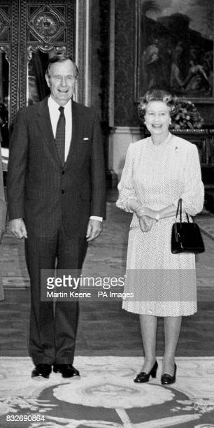 American President George Bush stands next to Queen Elizabeth II in the Picture Room at Buckingham Palace