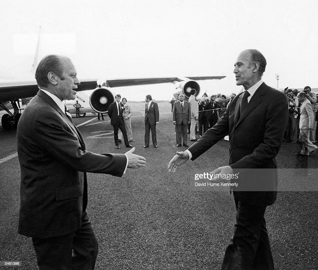 American President Gerald Ford (left) and French President Valery Giscard d'Estaing reach out the hands in gretting on an airport tarmac, Fort-de-Frnace, Martinique, December 14, 1974.