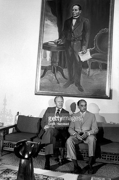 American President Gerald Ford and Mexican President Luis Echeverria sit togther under a giant painting on an unknown man Mexico October 21 1974