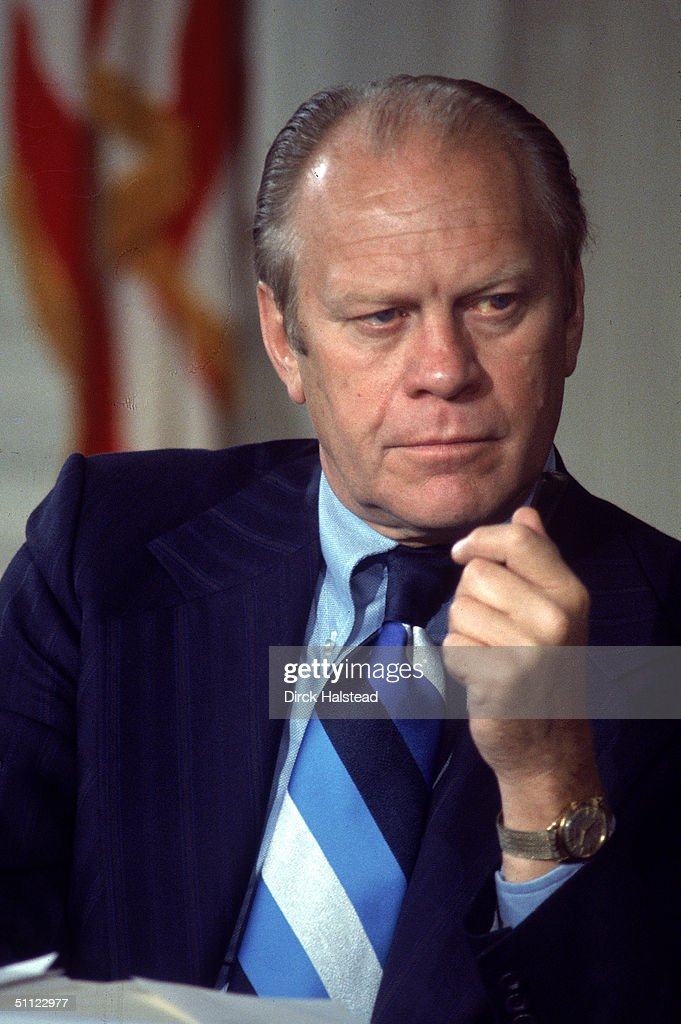 American President Gerald Ford listens during the opening session of a White House economic conference, Washington DC, September 1974.