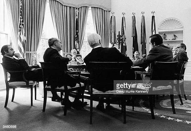 American President Gerald Ford meets with his senior advisors in the White House's Oval Office Washington DC October 9 1974 Left to right Press...