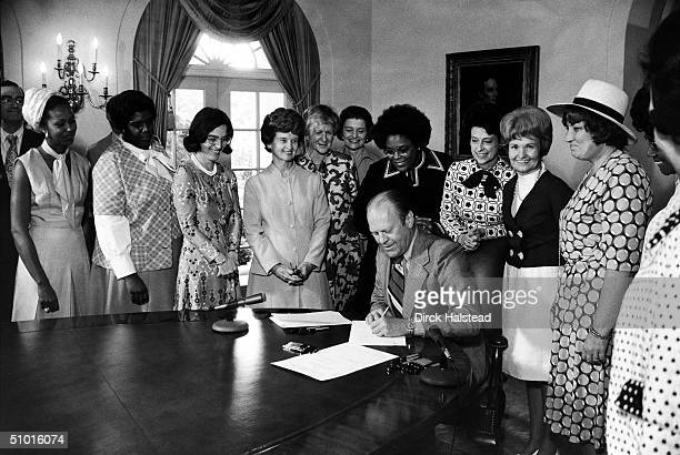 American President Gerald Ford signs legislation declaring August 26th Women's Equality Day Washington DC August 22 1974 Also present are from left...