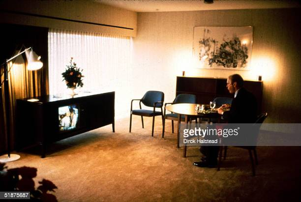American President Gerald Ford sits in his hotel suite and eats alone as he watches televised coverage of the Republican National Convention Kansas...