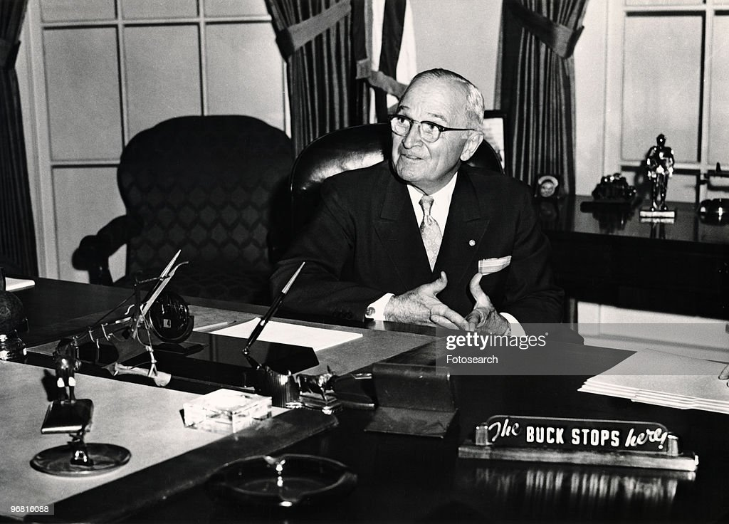 Truman sitting in Library : News Photo