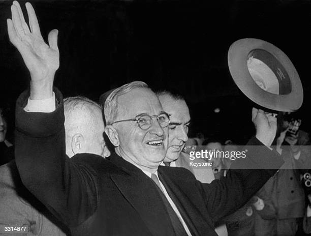 American President Harry S Truman smiles and waves to the excited Kansas City crowd after hearing the news that he had won the United States...