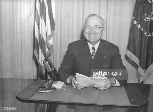 American President Harry S Truman smiles as he makes a national radio address on labor and wage controls Washington DC January 3 1946