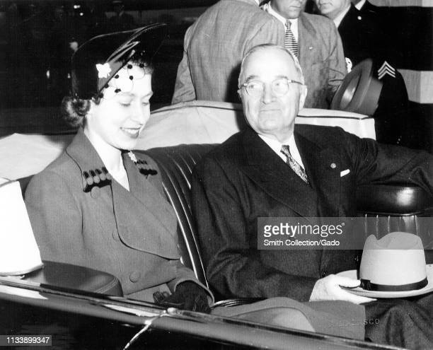 American President Harry Truman and Elizabeth II, sitting next to each other in the back of the Lincoln Cosmopolitan Presidential state car, with the...