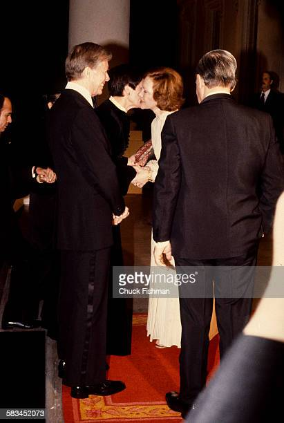American President Jimmy Carter left and his wife Rosalynn greet German Chancellor Helmut Schmidt right and his wife Loki second from left at the...