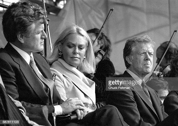 American President Jimmy Carter right sits with Senator Ted Kennedy left and his wife Joan center at the memorial dedication ceremony for the JFK...