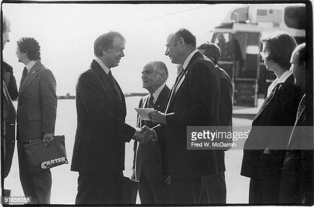 American President Jimmy Carter shakes hands with politician Ed Koch while then New York City Mayor Abraham Beame stands between them October 4 1977...