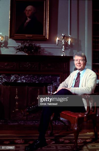 American President Jimmy Carter sits in the White House library for the first of his fireplace chats Washington DC February 2 1977 This talk...