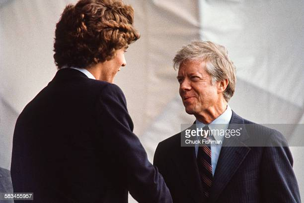 American President Jimmy Carter speaks with John F Kennedy Jr at the dedication ceremony for the John F Kennedy Presidential Library and Museum in...