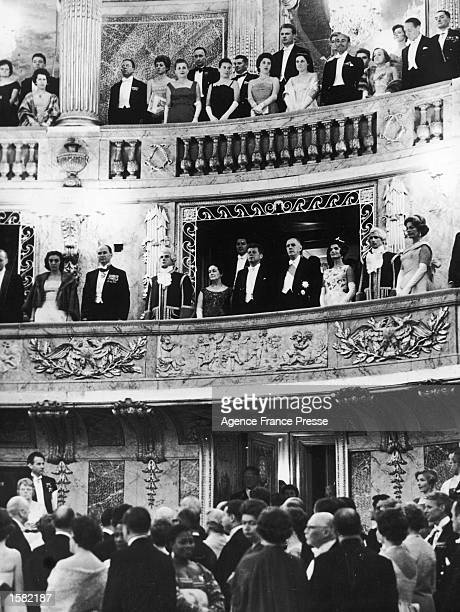 American president John F Kennedy and first lady Jacqueline Kennedy stand in the balcony with French president Charles de Gaulle his wife and other...