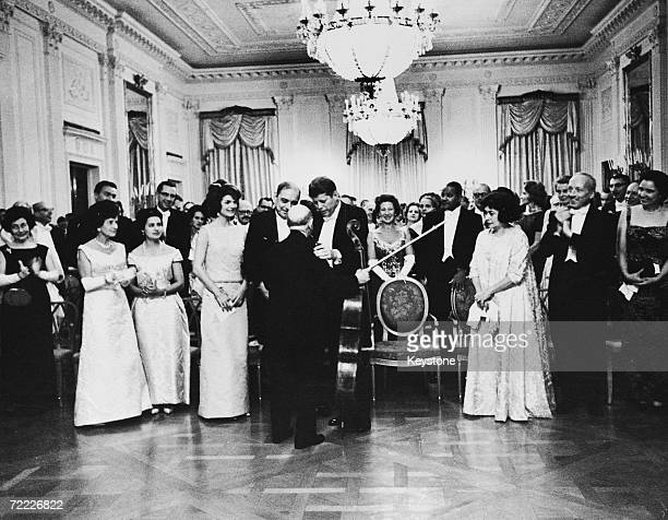 American president John F Kennedy and his wife Jackie congratulate Spanish cellist Pablo Casals after a private recital at the White House 24th...