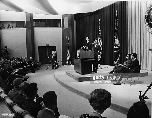 American president John F. Kennedy gives a press conference in the State Department Auditorium on the subject of the arms race and the threat of...