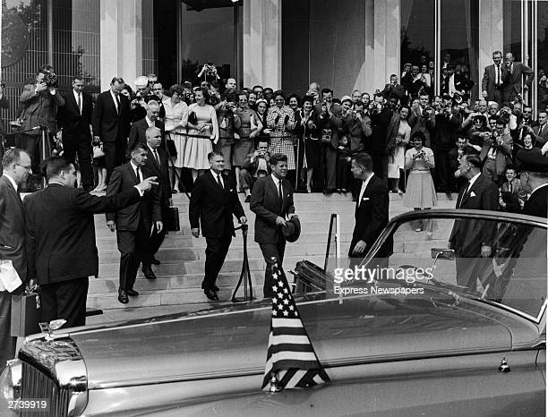 American President John F Kennedy leaves the American embassy with a large crowd of people gathered outside London June 5 1961