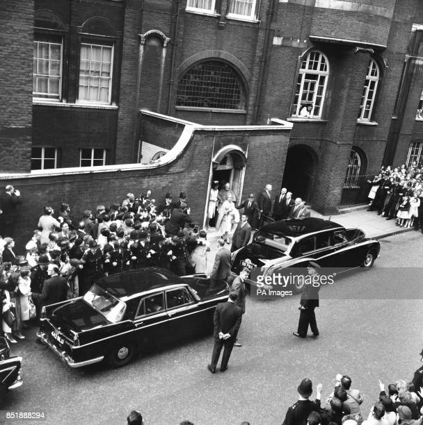 American President John F Kennedy leaves Westminster Cathedral after the christening of Anna Christina Radziwill with his wife Jacqueline following...